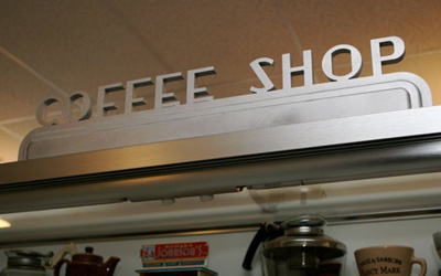 A Deco Coffee Shop Sign Fleshes Out the Collection Display