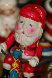 Vintage Santa on Bicycle Tin Toy