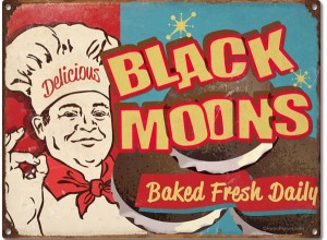 Black Moons Tin Sign