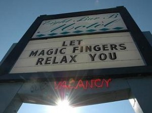 Hotel sign advertising Magic Fingers.