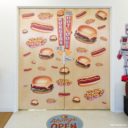 Kitchen door decorated with burgers & fries diner style decals.