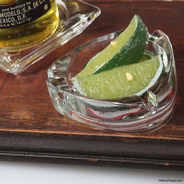 Lime wedges in vintage ashtray