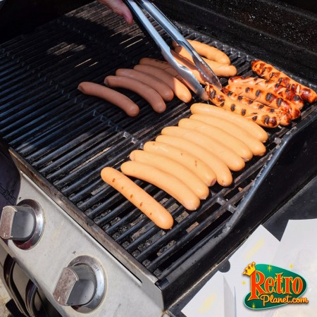 Hot dogs being grilled.