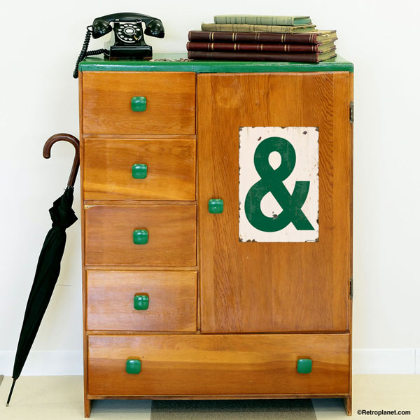 Ampersand Decal in Green applied to cabinet.