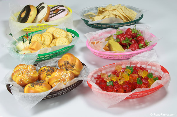 Plastic deli baskets with a variety of foods.