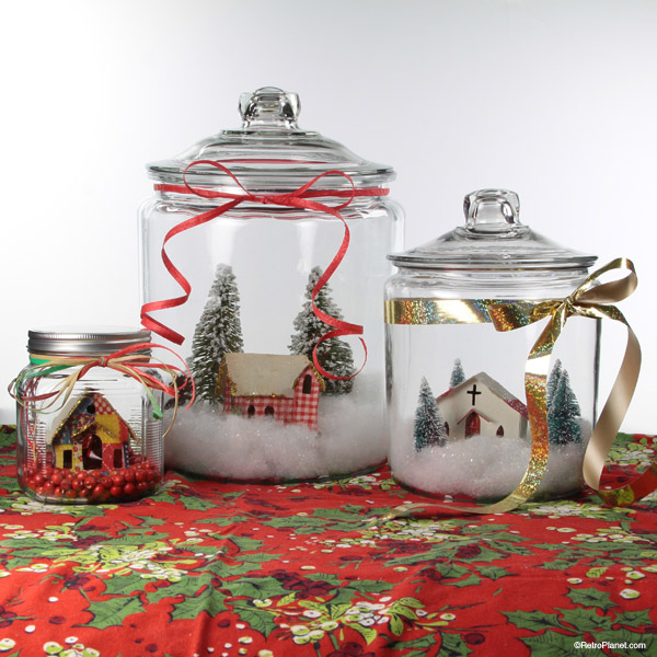 Jars filled with fake snow and Christmas decor.