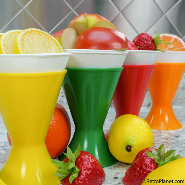 Yellow, green, red and orange cups filled with fruit