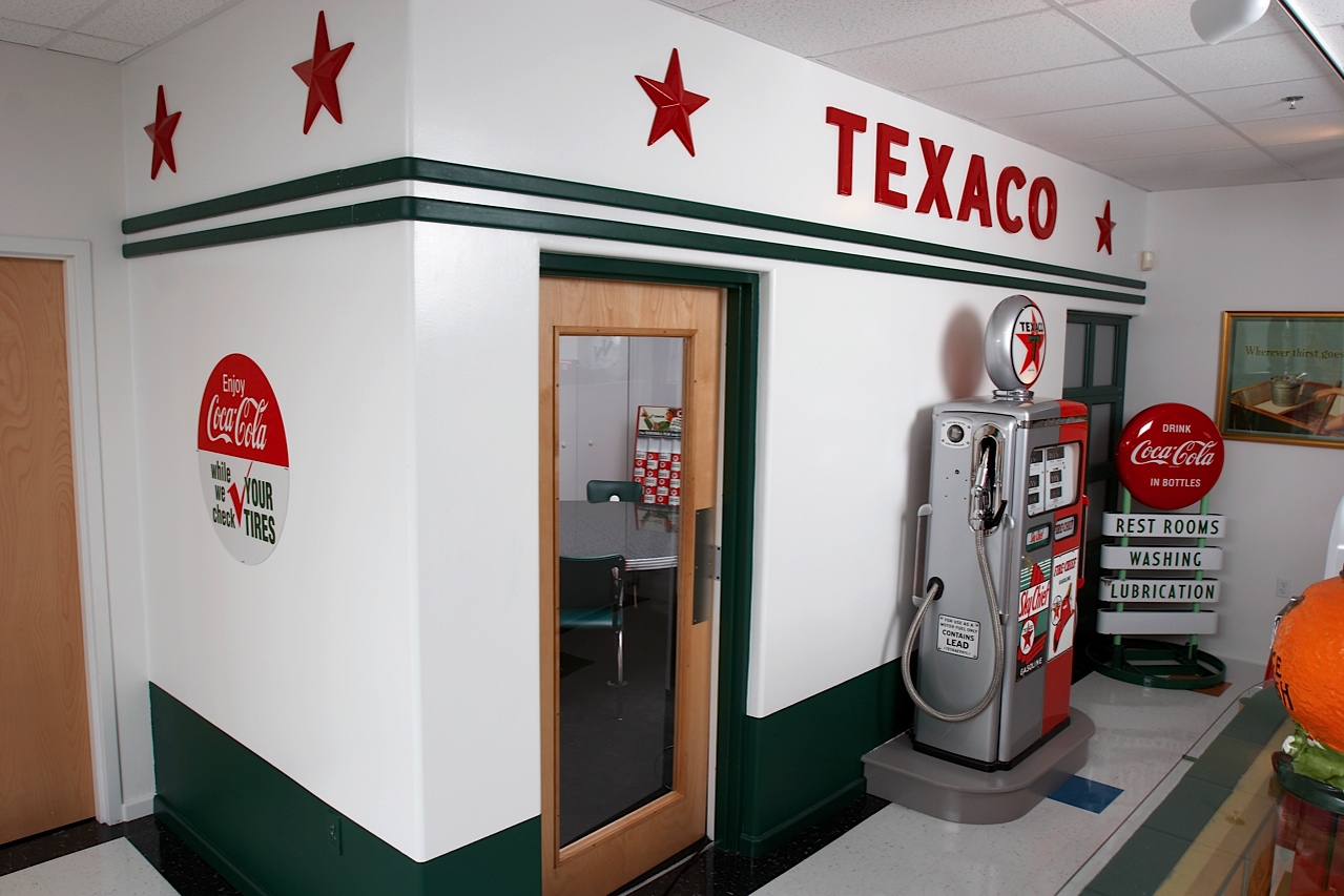 Outside of a conference room looking like an old Texaco station.