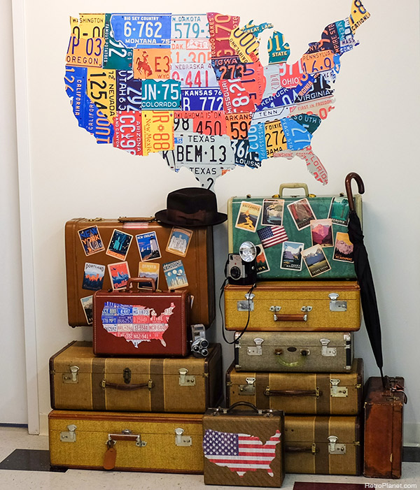 old luggage serves as great vintage decor and they make it easy to give your home a playful travel vibe - Travel Home Decor