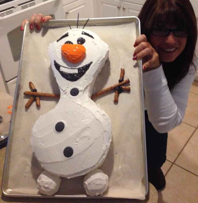 Sherri plays peek-a-boo with Olaf.