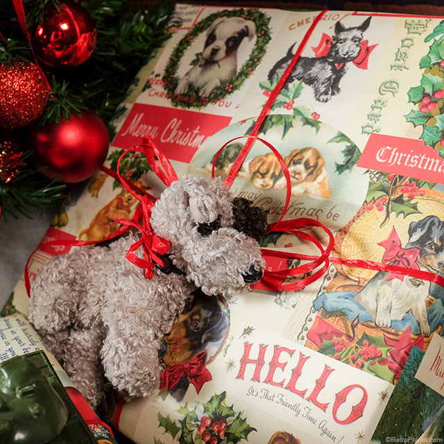 dog christmas wrap by cavallini papers presents decorated with toys