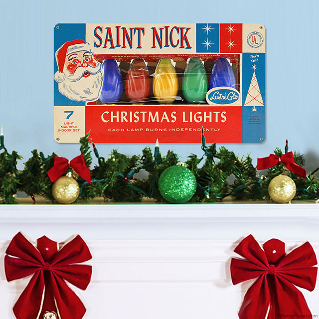 saint nick lights sign while decorating for christmas