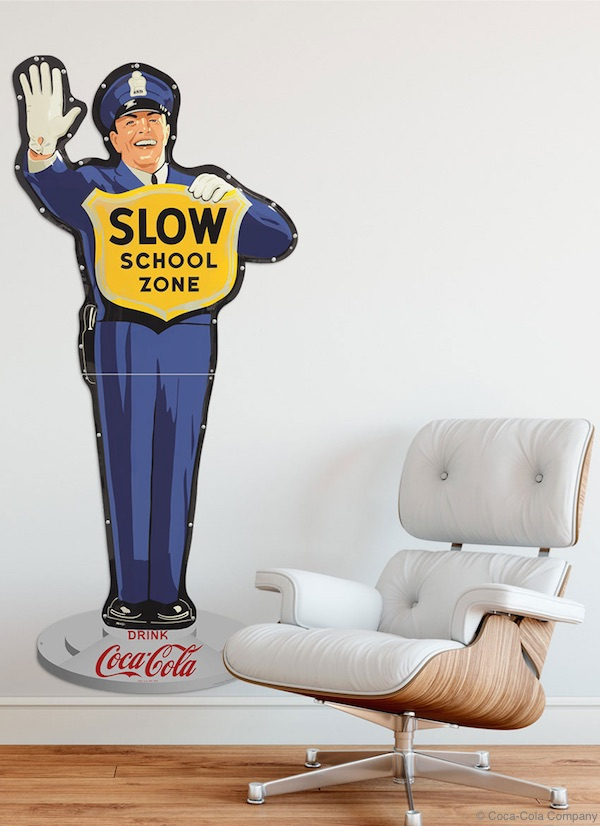 Coke Cop Sign in a Setting